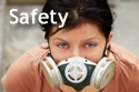 Text 'Safety,' with lady wearing respirator in background